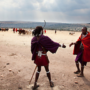 The Stars Foundation visiting S.A.F.E in the Loita Hills near the Tanzanian border in Kenya...It is mainly Maasais who live in the Loita Hills up above the Serengeti plains. They live in small villages and communities called bomas and live mainly of raising and selling live stock such as cattle and goats. Its a very remote region in Kenya, hard to get to without a four wheel drive with very little infrastructure and up till 2010 no mobile phone network. The Maasais are well known though out Kenya and the world for their colorful clothing and their way of keeping their old traditions alive...Sherssen,to the right, is greeting a friend. Its the end oof the day and the cattle and goat market day in Ilkerin is almost over. Sherssen is local and is a member of the S.A.F.E theatre group. S.A.F.E is a charity which educates children and young people about life skills and how to protect themselves from HIV and other STIs through performance. They also do performances about Female Genital Mutilation, an old tradition amongst the Maasais in Loita and a very brutal and controversial custom which S.A.F.E is trying to eradicate.