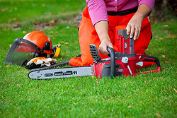 Rechargeable battery powered cordless chainsaw and safety helmet
