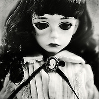 portrait of sad colette the doll