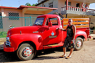 Man and pickup truck Artemisa, Cuba.