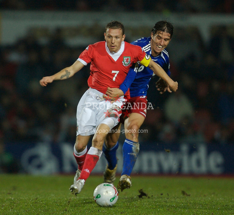 WREXHAM, WALES - TUESDAY, NOVEMBER 14th, 2006: Wales' Craig Bellamy and Liechtenstein's Martin Stocklasa during the International Friendly match at the Racecourse Ground. (Pic by David Rawcliffe/Propaganda)