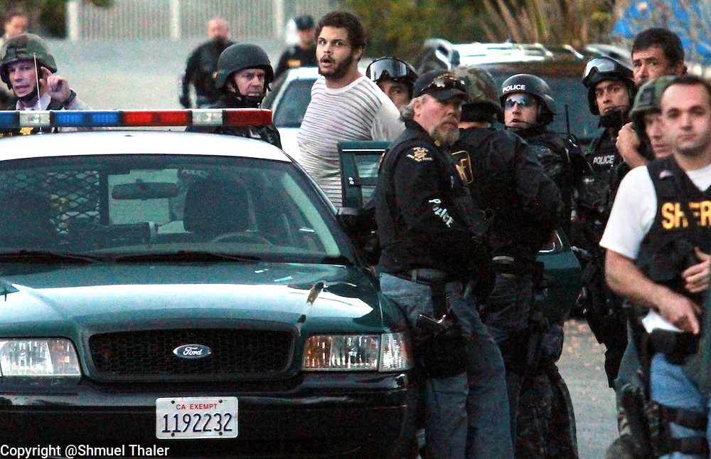 Maurice Ainsworth is taken into custody on English Drive in Santa Cruz, California on Monday November 29, 2010 after a 5-hour police manhunt. Ainsworth, who was being held in Santa Cruz County Jail, was being transported to Dominican Hospital for medical tests when he turned a Sheriff's deputy's taser on her and escaped. He was arrested without injuries.<br />Photo by Shmuel Thaler/Santa Cruz Sentinel