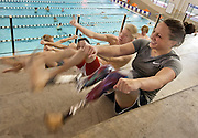 Lehi High School swimmer Amy Chapman laughs as she performs bicycles during dry land practice at the Lehi Legacy Center, Tuesday, Dec. 18, 2012. Chapman, 17, was born with fibular hemimelia and had both legs amputated when she was 13 months old.