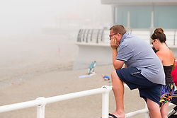 &copy; Licenced to London News Pictures<br /> Aberystwyth,UK. 8/07/2018. A man looks over the beach on a  misty morning in Aberystwyth, as the sea mist rolls in off Cardigan Bay to take the edge off the temperatures on the west wales coast. <br /> Over much of the UK  the prolonged  heat wave and very dry weather continues unbroken, with temperatures expected to climb again towards the end of the week. Photo credit Keith Morris/LNP