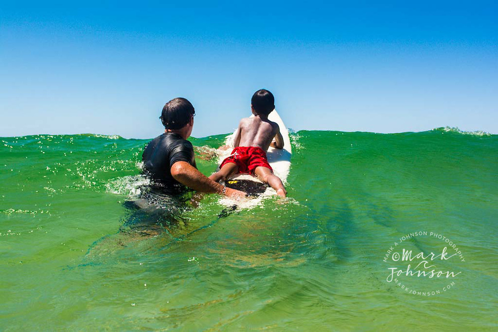 Father teaching his 6 year old boy how to surf, Coolangatta Beach, Gold Coast, Queensland, Australia