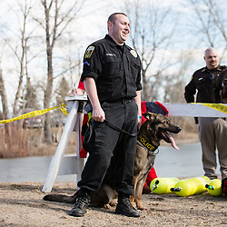 Office Josh Ray and his partner Filu of the Helena Police Department wait to jump during Helena's annual Passion Plunge.  The Passion Plunge is a fundraiser for the Special Olympics and this year raised more that $24,000.
