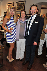Left to right, AMBER NUTTALL, GYTHA BOUCHON and ALEXANDER MAVROS at a party to celebrate the launch of the new Mauritius Collection of jewellery by Forbes Mavros held at Patrick Mavros, 104-106 Fulham Road, London SW3 on 5th July 2011.