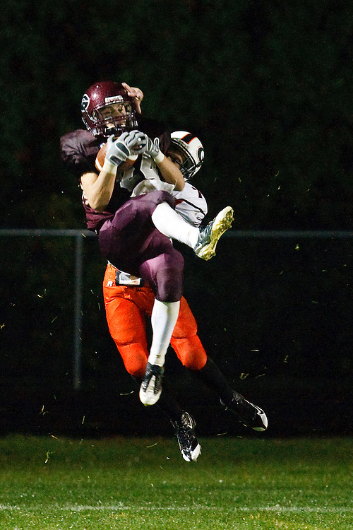October 9, 2009:  Derrek Allgier of Genoa (24) catches a pass over Vincent Kirsch of Gibsonburg (7) during the High School football game between Gibsonburg Bears and Genoa Comets at Genoa Stadium in Genoa, Ohio.