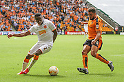 Hull's Moses Odubajo & Wolves Scott Golbourne during the Sky Bet Championship match between Wolverhampton Wanderers and Hull City at Molineux, Wolverhampton, England on 16 August 2015. Photo by Shane Healey.
