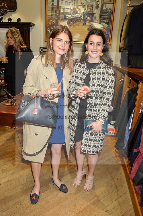 Left to right, ANNE VOGT and SASHA SASSOON at a private view of photographs by Gray Malin 'Beaches' held at Huntsman, 11Savile Row, London on 20th June 2016.