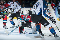 KELOWNA, CANADA - DECEMBER 7: Jackson Whistle #1 of the Kelowna Rockets deflects a shot against the Kootenay Ice on December 7, 2013 at Prospera Place in Kelowna, British Columbia, Canada.   (Photo by Marissa Baecker/Shoot the Breeze)  ***  Local Caption  ***