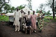 SOUTH SUDAN. IL CAPO FAMIGLIA ALBAKAR FOKI CON LA SUA FAMIGLIA DAVANTI ALLA LORO TENDA NEL CAMPO RIFUGIATI DI YUSUF BATIL NELLA REGIONE DI MABAN. A CAUSA DEI BOMBARDAMENTI DI KARTHUM SONO FUGGITI A PIEDI DAL SUDAN, DAL VILLAGGIO DI DERA, NEL BLUE NILE STATE, DOVE VIVEVANO E COLTIVAVANO LA LORO TERRA;