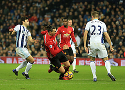 17 December 2016 - Premier League - West Bromwich Albion v Manchester United - Zlatan Ibrahimovic of Manchester United is tripped by Claudio Yacob of West Bromwich Albion - Photo: Paul Roberts / Offside.