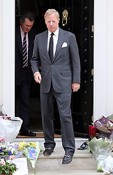 Sir Mark Thatcher looks at the  flowers outside Baroness Thatcher's house in London, Wednesday, 10th April 2013 Photo by: Stephen Lock / i-Images