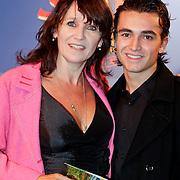 NLD/Amsterdam/20111010 - Premiere All Stars 2, Renee Fokker en zoon Daan