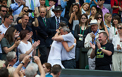 LONDON, ENGLAND - Saturday, July 5, 2014: Petra Kvitova (CZE) embraces her father Jiri after winning the Ladies' Singles Final match on day twelve of the Wimbledon Lawn Tennis Championships at the All England Lawn Tennis and Croquet Club. (Pic by David Rawcliffe/Propaganda)