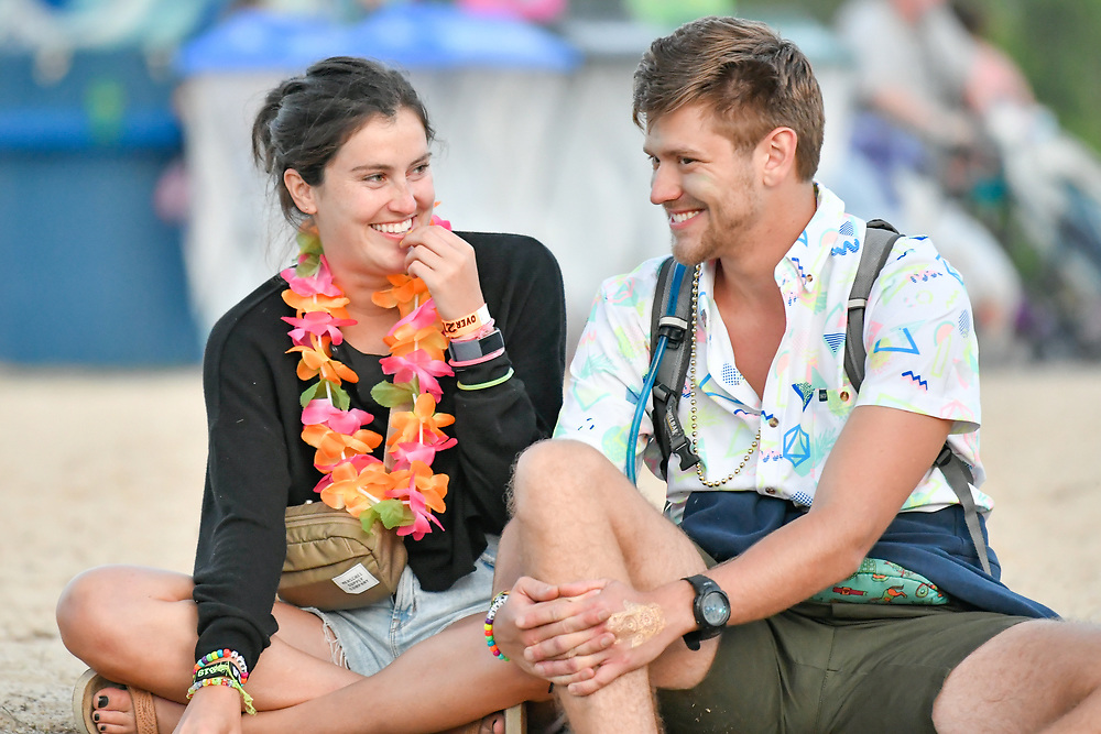 Two friends take some time to rest while attending The Bonnaroo Music and Arts Festival in Manchester, TN