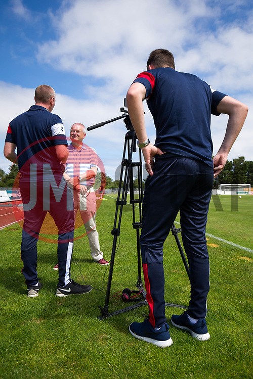 Bristol City owner and Guernsey resident Steve Lansdown is interviewed by Adam Baker as he attends the game - Rogan/JMP - 08/07/2017 - Footes Lane - Guernsey - Guernsey FC v Bristol City - Pre-season Friendly.