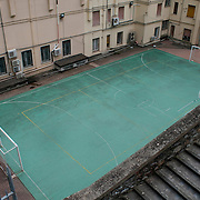 Because soccer is the country's most popular sport, small, green cement pavement marked as a soccer field can be seen behind the historic buildings in the village of Manrola in the Cinque Terre region of Italy.