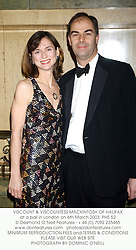 VISCOUNT & VISCOUNTESS MACKINTOSH OF HALIFAX at a ball in London on 6th March 2003.PHS 52