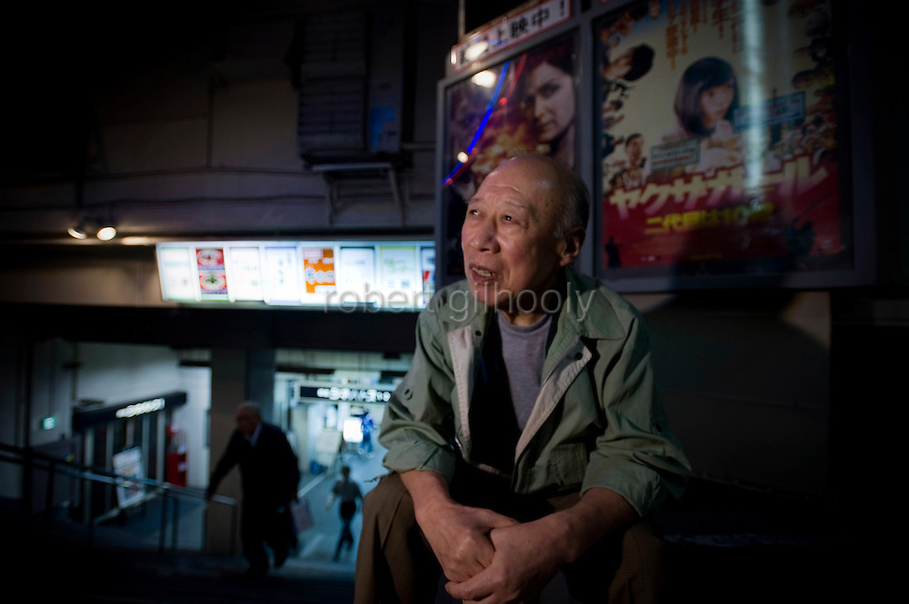 Porn star Shigeo Tokuda, 77, poses for a photo outside a small cinema in Tokyo, Japan on 17 Oct. 2011. Photograph: Robert Gilhooly