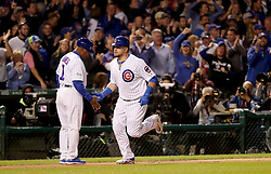 October 17, 2017 - Chicago, IL, USA - The Chicago Cubs' Kyle Schwarber, right, heads to the plate after hitting a solo home run in the first inning against the Los Angeles Dodgers during Game 3 of the National League Championship Series at Wrigley Field in Chicago on Tuesday, Oct. 17, 2017. (Credit Image: © Brian Cassella/TNS via ZUMA Wire)