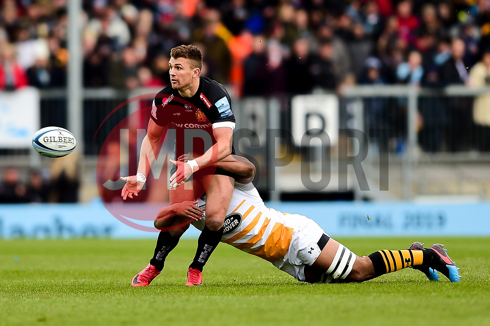 Henry Slade of Exeter Chiefs is tackled by Nizaam Carr of Wasps - Mandatory by-line: Ryan Hiscott/JMP - 14/04/2019 - RUGBY - Sandy Park - Exeter, England - Exeter Chiefs v Wasps - Gallagher Premiership Rugby