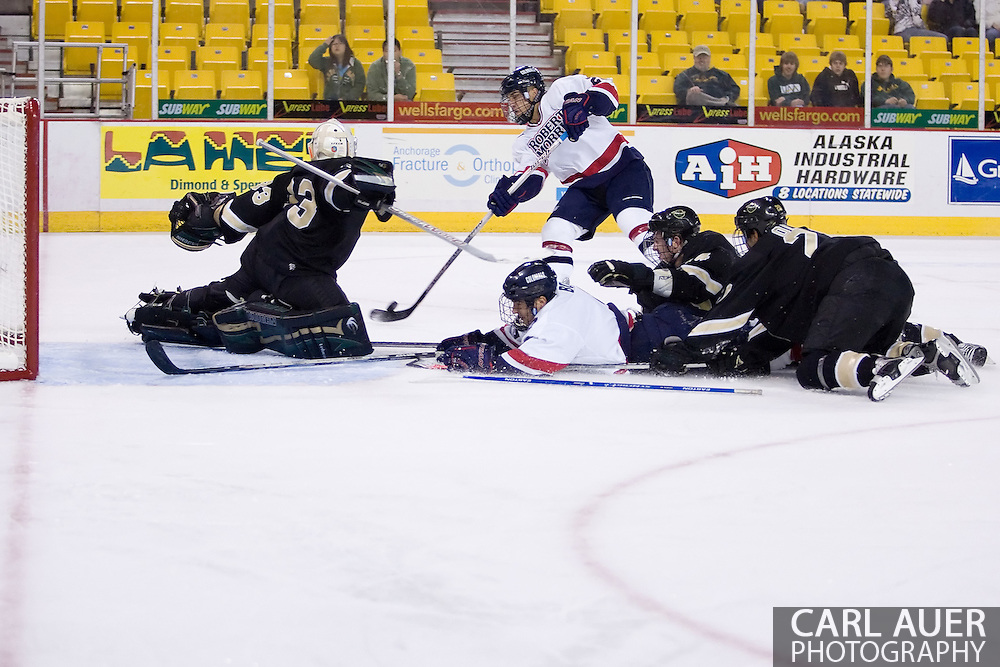 October 13, 2007 - Anchorage, Alaska: Jason Towsley (20) of the Robert Morris Colonials tries to one time a shot past the Warrior goalie in the Colonials 4-1 victory over the Wayne State Warriors at the Nye Frontier Classic at the Sullivan Arena.