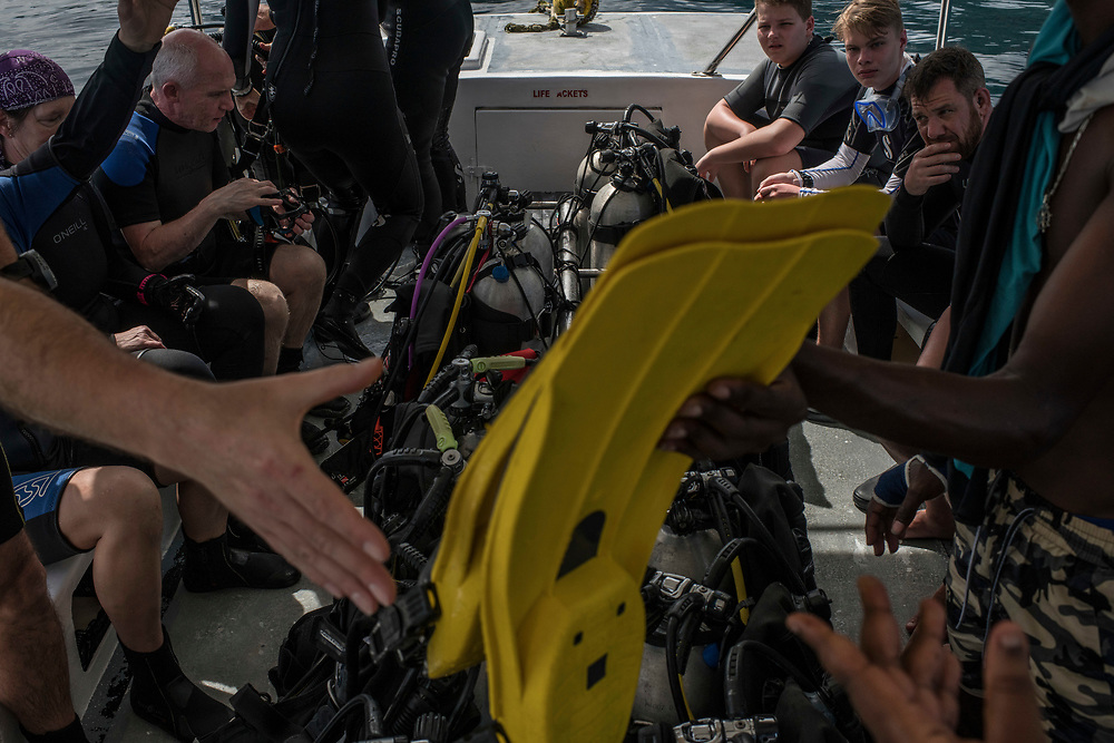 Recreation divers prepare for their dive off the beach in Beau Vallon, Seychelles on February 21, 2018. Tourism is one of the country's main income generators.<br /> <br /> The government of Seychelles has created 81,000 square miles of Marine Protected Areas as part of a conservation debt swap deal in an effort to shield marine ecosystems from unsustainable development and climate change while safeguarding its economy.