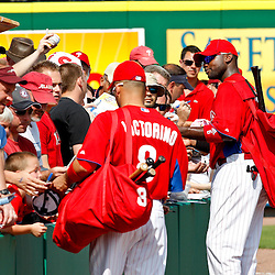 February 24, 2011; Clearwater, FL, USA; Philadelphia Phillies center fielder Shane Victorino (8) and first baseman Ryan Howard (6) sign autographs for fans during a spring training exhibition game against Florida State University at Bright House Networks Field. Mandatory Credit: Derick E. Hingle