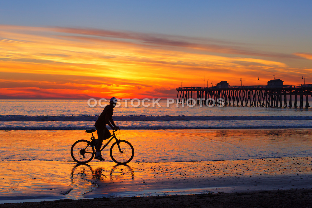 Bike Riding on the Beach at Low Tide at the San Clemente Pier