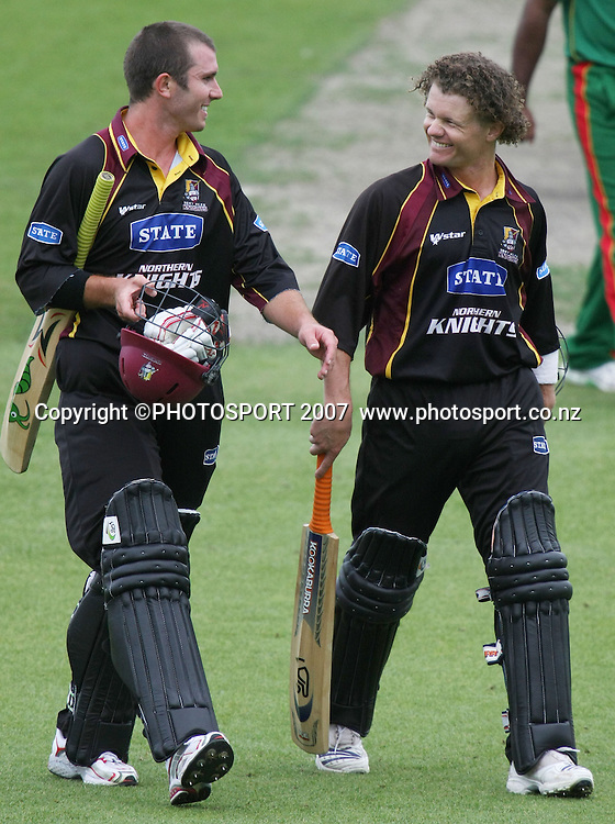 Grant Robinson and James Marshall leave the field after winning the match. Northern Knights v Bangladesh. One day tour cricket match. Seddon Park, Hamilton. Sunday 16 December 2007. Photo: Stephen Barker/PHOTOSPORT