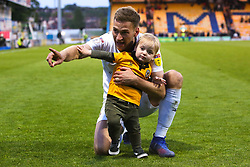 Mickey Demetriou of Newport County celebrates his sides victory with his son over Mansfield Town to send Newport County to the play-off final - Mandatory by-line: Ryan Crockett/JMP - 12/05/2019 - FOOTBALL - One Call Stadium - Mansfield, England - Mansfield Town v Newport County - Sky Bet League Two Play-Off Semi-Final 2nd Leg