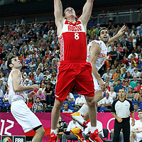 10 August 2012: Russia Sasha Kaun dunks the ball during 67-59 Team Spain victory over Team Russia, during the men's basketball semi-finals, at the North Greenwich Arena, in London, Great Britain.