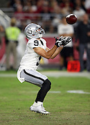 Oakland Raiders rookie punt returner Joe Hansley (9) catches a punt during the 2016 NFL preseason football game against the Arizona Cardinals on Friday, Aug. 12, 2016 in Glendale, Ariz. The Raiders won the game 31-10. (©Paul Anthony Spinelli)