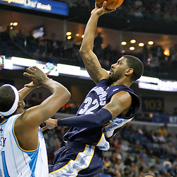 Jan 20, 2010; New Orleans, LA, USA; Memphis Grizzlies guard O.J. Mayo (32) shoots over New Orleans Hornets forward James Posey (41) during the first half at the New Orleans Arena. Mandatory Credit: Derick E. Hingle-US PRESSWIRE