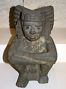 Seated stone figure of Xiuhtecuhtli: Aztec, AD 1325-1521, from Mexico. Xiuhtecuhtli, was the Aztec god of fire.  Pre-Columbian Mesoamerican Mythology Sculpture
