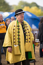 © Licensed to London News Pictures. 11/10/2015. Southwick, UK. Picture shows King Conker with his walking stick made of conkers including a built in beer holder. The 2015 Conker World Championships celebrates it's 50th year with competitors from around the world competing to become this years conker king. Photo credit: Andrew McCaren/LNP