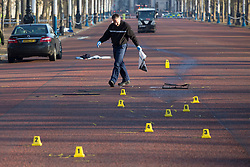© licensed to London News Pictures. London, UK 30/11/2012. Forensic officers investigating a scene at The Mall, where a pedestrian has died after being struck by two cars, near Buckingham Palace in central London. Photo credit: Tolga Akmen/LNP
