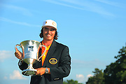 Rickie Fowler with the trophy after winning the Wells Fargo Championship at the Quail Hollow Club on May 6, 2012 in Charlotte, N.C. Fowler won in a three-way playoff with Rory McIllroy and D.A. Points...©2012 Scott A. Miller.