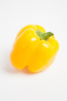 Close-up of yellow bell pepper over white background