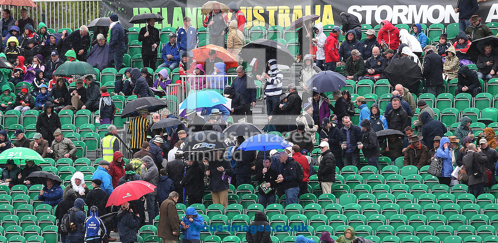 Umbrellas up and the covers come on in Malahide as rain stops play with Ireland struggling at 56 for 4 during the One Day International match at the Village, Malahide<br /> Picture by Lorraine O'Sullivan/Focus Images Ltd +353 872341584<br /> 08/05/2015