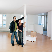 couple inside an empty loft appartement moving in