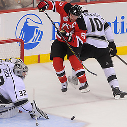 May 30, 2012: Los Angeles Kings center Mike Richards (10) checks New Jersey Devils left wing Zach Parise (9) to stop his wraparound shot during third period action in game 1 of the NHL Stanley Cup Final between the New Jersey Devils and the Los Angeles Kings at the Prudential Center in Newark, N.J.