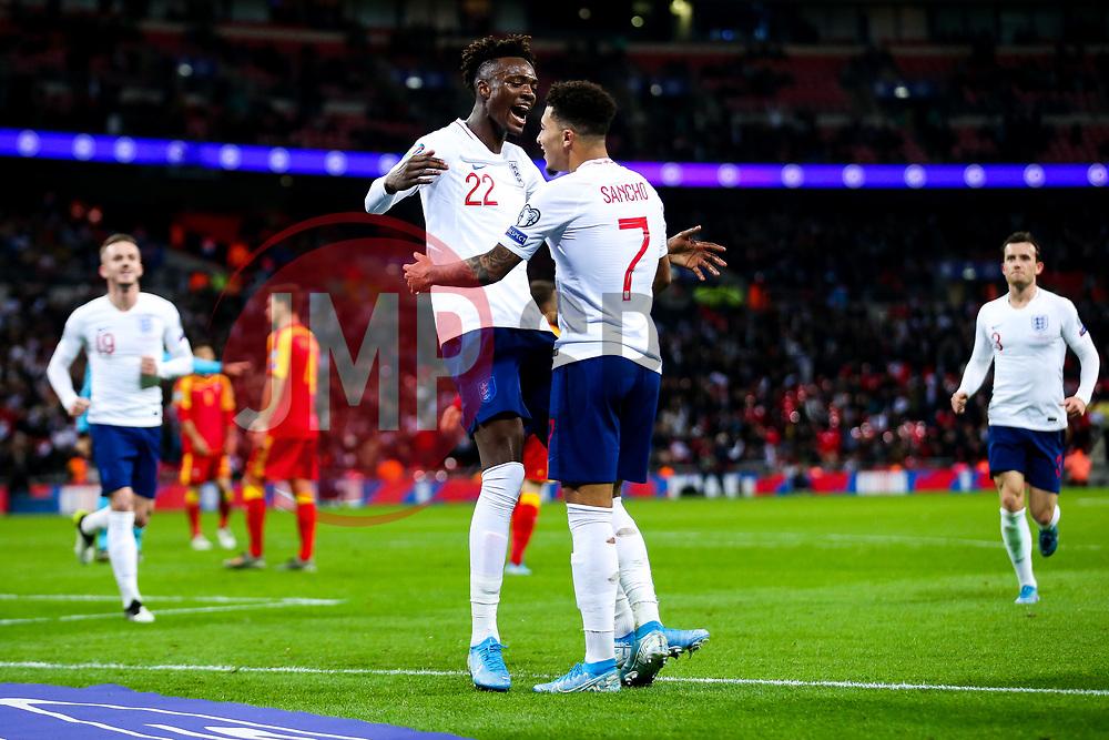Tammy Abraham of England celebrates with Jadon Sancho after scoring a goal to make it 7-0 - Rogan/JMP - 14/11/2019 - FOOTBALL - Wembley Stadium - London, England - England v Montenegro - UEFA Euro 2020 Qualifiers.