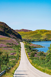 Remote highway A894 part of North Coast 500 tourist route, in Highland Region, near Scourie north Scotland in summer,United Kingdom