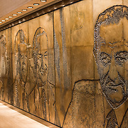 "A large mural, titled ""A Life in Politics"", designed by Naomi Savage and engraved on magnesium, dating to 1971. The mural, on display in the museum of the LBJ Library, shows LBJ with the presidents he worked with in his political career. The LBJ Library and Museum (LBJ Presidnetial Library) is one of the 13 presidential libraries administered by the National Archives and Records Administration. It houses historical documents from Lyndon Johnson's presidency and political life as well as a museum."