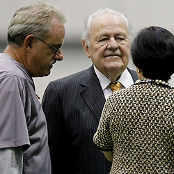 July 27, 2012; Metairie, LA, USA; New Orleans Saints owner Tom Benson and his wife Gayle Benson talk with assistant head coach and linebacker coach Joe Vitt during training camp at the team's indoor practice facility. Mandatory Credit: Derick E. Hingle-US PRESSWIRE