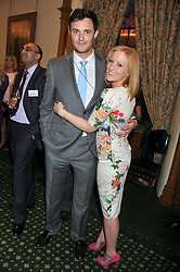 Sky Sports presenter SARAH JANE MEE and JAMES SNOW at a reception for The Mirela Fund in partnership with Hope and Homes for Children hosted by Natalie Pinkham in The Churchill Room, House of Commons, London on 30th April 2013.