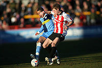 Danny Senda left for Wycombe, Danny Wilson right for Cheltenham<br /> <br /> Photo: Richard Eaton.<br /> <br /> Cheltenham Town v Wycombe Wanderers. Coca Cola League 2. 04/03/2006.